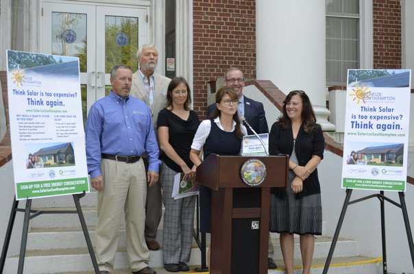 Southampton Town officials at a press conference for Solarize Southampton on Thursday. BY ERIN MCKINLEY