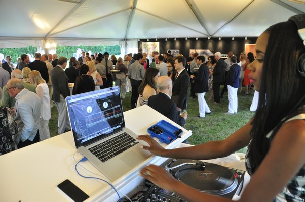 DJ Kiss spins during the cocktail party. MICHELLE TRAURING