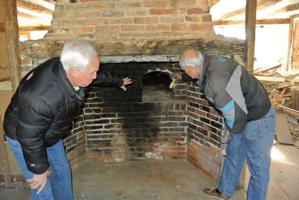 Larry Jones and Bob Hirt examine the bake oven.