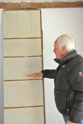 Larry Jones with one of the wide wooden planks found in the house.