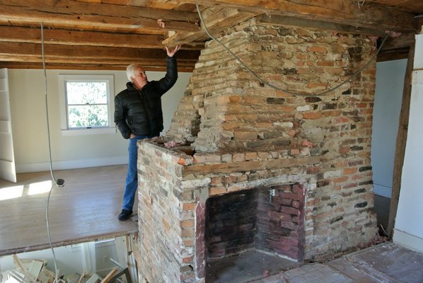 Larry Jones shows some of the original timber beams on the second floor of the house.