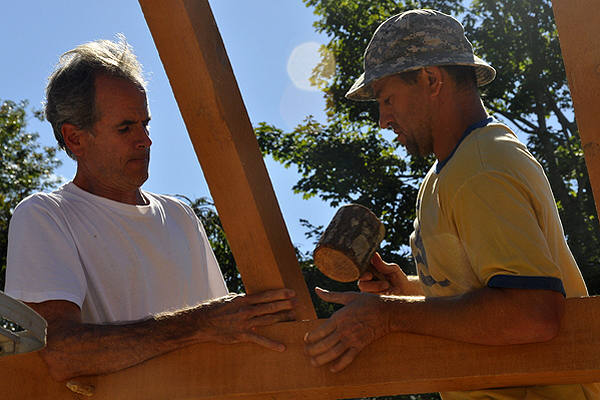 Jon Pines and Jay Comella install the roof. MICHELLE TRAURING