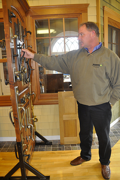 Randy Allen looks over an assortment of lock sets at Permiters in Water Mill. MICHELLE TRAURING