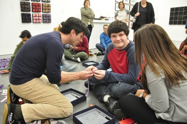 Steven and William Ladd brought their Scrollathon project to the Parrish Art Museum in Water Mill, where they will work with more than 1,000 children over the course of three weeks. MICHELLE TRAURING