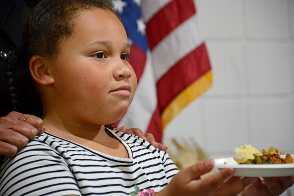 Kellis Quinn, 6, presents a plate as an offering to the ancestors for gracing them with a bountiful harvest. JD ALLEN