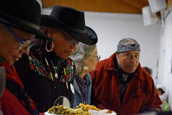 Robin Weeks, Shane's father, and the rest of the elders get first dibs at the feast prepared for