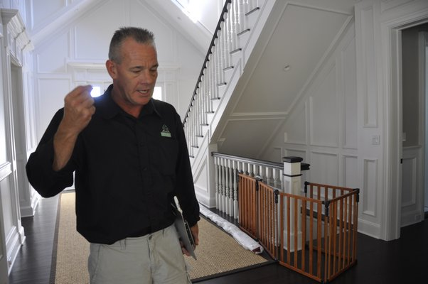 Chris Capalbo inspects a home in Sag Harbor. MICHELLE TRAURING