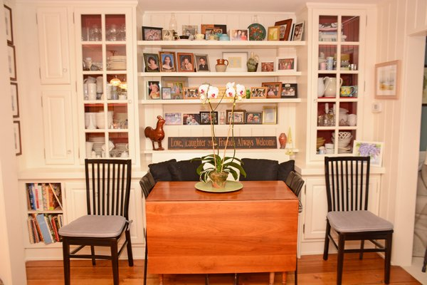 A wall unit houses recent family photos and memories. JD ALLEN