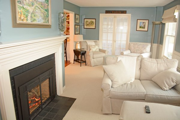 A roaring fire burns in the gas fireplace in the living room. The room offers several nooks and crannies. JD ALLEN