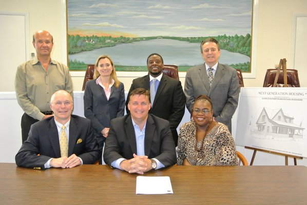 At Southampton Village Hall with the Bailey Road house renderings, standing, left to right, Stephen Funsch, Sarah Gurley, Curtis Highsmith, Richard Blowes. Seated, John Rose, Mark Epley and Michelle Cannon. DANA SHAW