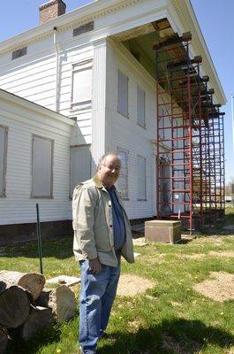 Bridgehampton Historical Society Executive Director John Eilertsen stands in front of the Nathaniel Rogers House in Bridgehampton. By Shaye Weaver