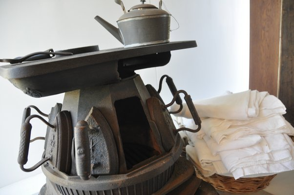 This cast-iron ironing stove was often found in Southampton estates in the early 1900s. MICHELLE TRAURING