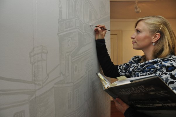 Emma Ballou is painting a mural of a castle-like Southampton summer estate, Ville Mille Fiori. MICHELLE TRAURING