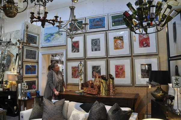 Zoe Hoare, left, and Chris Mead are selling a collection of Chagall prints at English Country Antiques in Bridgehampton. MICHELLE TRAURING