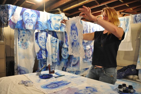 Aubrey Roemer will paint 400 portraits of Montauk locals by summer's end. MICHELLE TRAURING