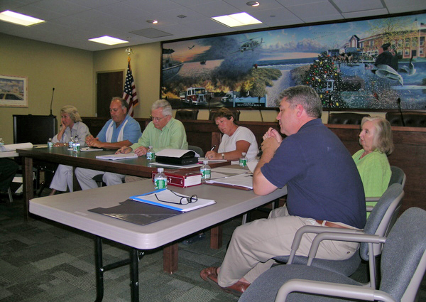 Village officials and board members at the August 26 work session. <br></noscript>Photos by Hallie D. Martin