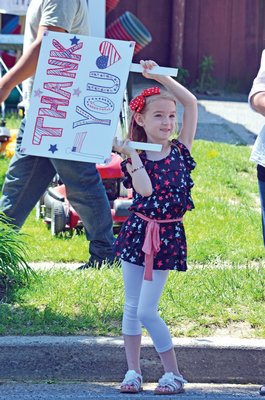 May 30: Emily Rose, 6, has a special message for veterans during the Hampton Bays Memorial Day parade.