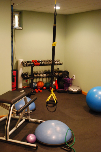 The gym that personal trainer Donna Pierro installed in her Flanders home. <br></noscript>Photo by Will James