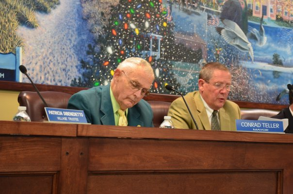 Westhampton Beach Mayor Conrad Teller, left, and trustee Ralph Urban at the May trustee meeting. BY ERIN MCKINLEY