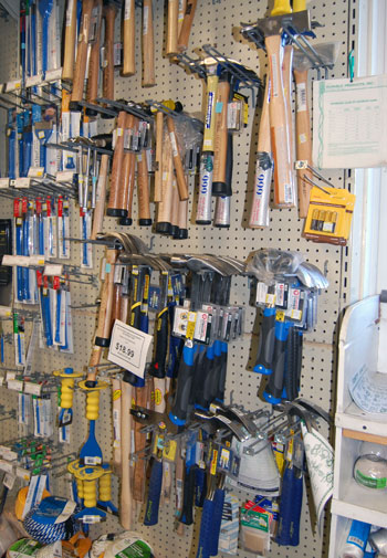 Ted Jankowski of Westhampton True Value Hardware models some basic tools.