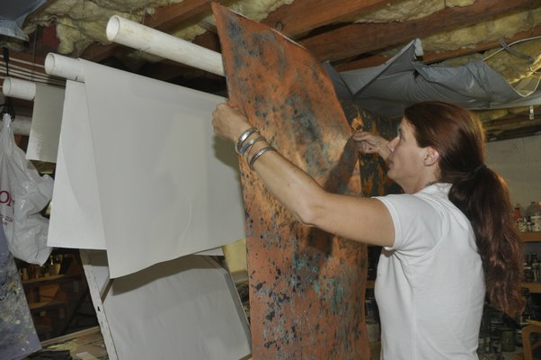 Heather Dunn makes faux bois wallpaper in her East Hampton studio. MICHELLE TRAURING
