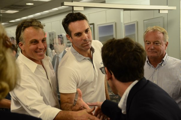 Candidates Andrew Pilaro, left, and Mark Parash shake hands with Joseph McLoughlin after they were elcted to the Southampton Village Board on Friday night. GREG WEHNER
