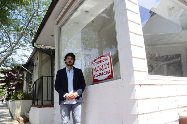 Southampton Village Mayor Jesse Warren stands in front of a vacant store on Jobs Lane. GREG WEHNER