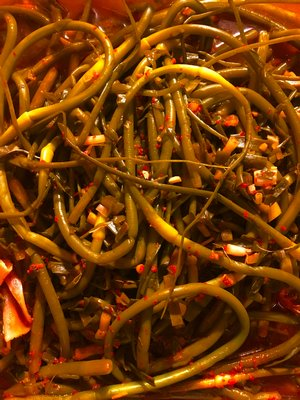 A still-fermenting batch of garlic scape kimchi.  HANNAH SELINGER