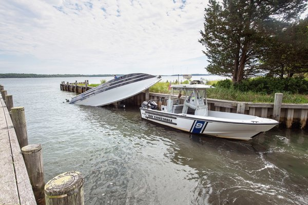 Seen Sunday, the 39-foot boat that crashed into a North Haven dock on Saturday night and overturned.