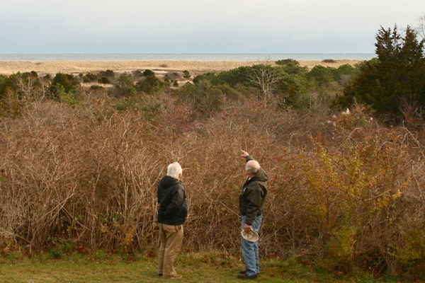 Councilman Dominick Stanzione and East Hampton Town Natural Resources Director Larry Penny in front of a blocked view on Bluff Road in Amagnsett. KYRIL BROMLEY