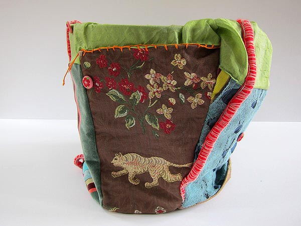 Embroidered patchwork and embellished bag, with a terra cotta pot inside, by Jill Musnicki. COURTESY ALEXANDRA EAMES