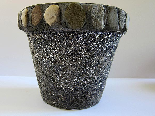 Painted and sand-covered terra cotta pot with glitter and beach stones on the rim by Jocelyn Worrall. COURTESY ALEXANDRA EAMES