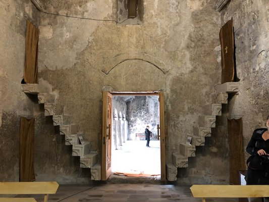 Dadivank monastery in Artsahk built for St. Dadi in 1214. Stairs leading to monks cells in nave.  ANNE SURCHIN