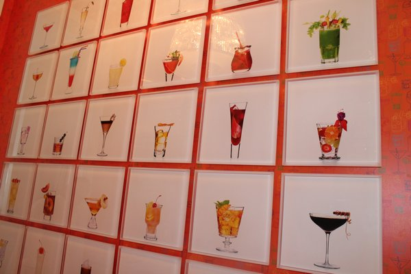 "The bar features a wall of photos taken from designer Mark Addison's recent book, ""Cocktail Chameleon.""  JULIA HALSEY"