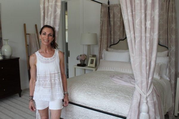 North Fork Designer Kate Singer inside the bedroom she curated for the Hampton Designer Showhouse.  JULIA HALSEY