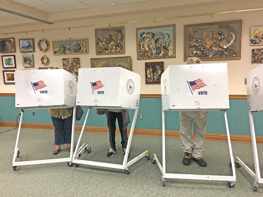 Voting in Hampton Bays on Tuesday morning.
