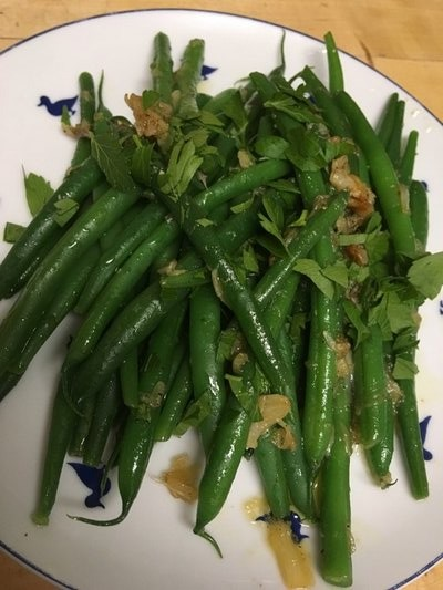 Braised garlic and green beans. BY JANEEN SARLIN