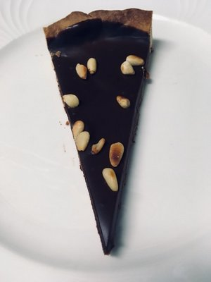 A slice of decadent dark chocolate tart BY JANEEN SARLIN