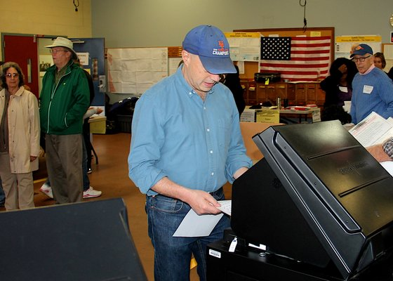 Democratic congressional candidate Perry Gershon votes at the East Hampton firehouse on Tuesday morning. KYRIL BROMLEY