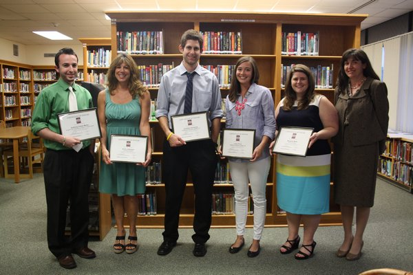 Sag Harbor School District employees Anthony Chase Mallia, Anita LaGrassa, Jonathan Schwartz, Lacey Price, Margaret Motto and Claire Michelle Viola (left to right), all were honored on at the school board meeting on Monday, June 17. Brandon B. Quinn