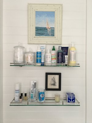 Displaying amenities on glass shelves is not only practical but can look beautiful. MARSHALL WATSON