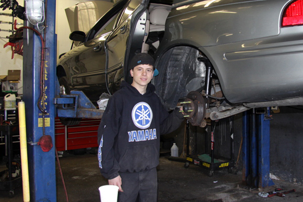 Devon Grisham, of East Hampton, works after school at East Hampton Auto. Devon wants the school district to allow him to walk at high school graduation though he attends a GED program.