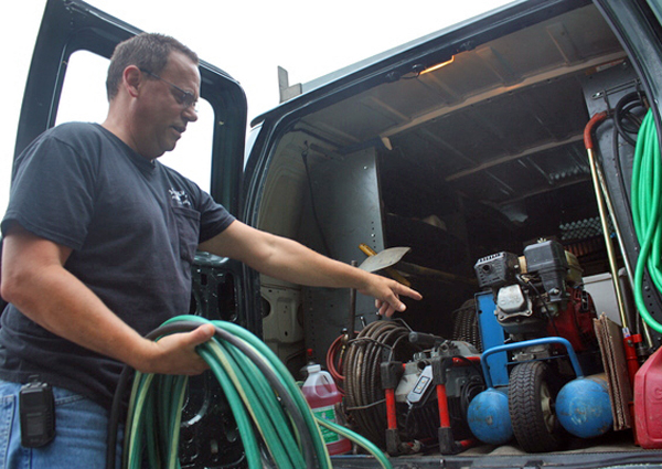 Dave Alberti, a master plumber at J.P. Mulvey in Hampton Bays, shows off some of the company's winterization equipment.