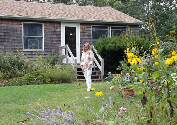 Tina Guglielmo's East Hampton home has a 10 kilowatt photovoltaic system intalled on their roof. Their electricity bill is $5.60 a month.