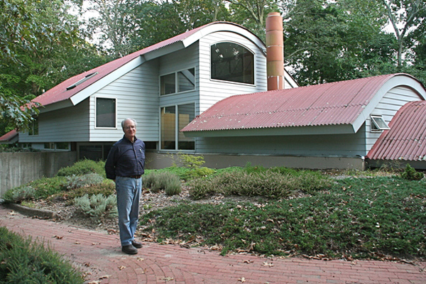 Bill Chaleff stand in front of his East Hampton home. His was one of the first solar houses in East Hampton. Chaleff's architectural firm has been building solar homes since 1976.