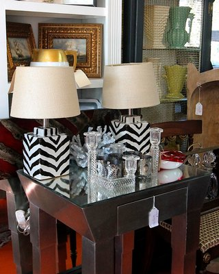 Statement piece: a silver Deco side table with tapered legs, beveled mirror top and drawer. On consignment from an antique shop, it's priced at $95.
