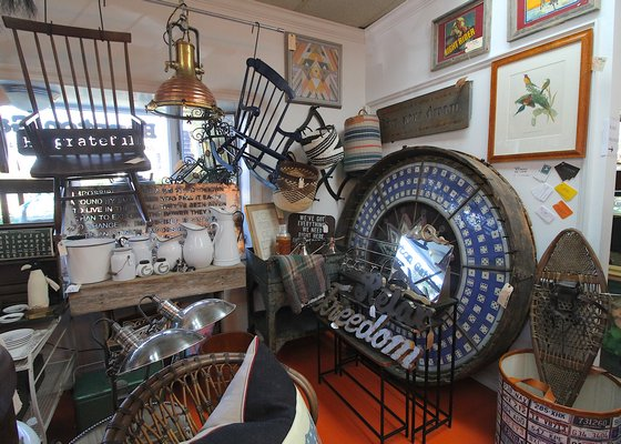 An 1890s antique carnival wheel from Vermont come with its original round wood case and has eteched mirror and blue glass detail. It can be wall-mounted as a sculptural piece or made into a coffee table and sells for $8,500. KYRIL BROMLEY