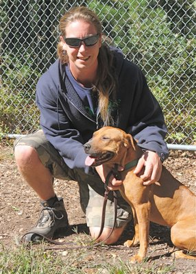 Pretty Girl, pictured with trainer Mike Hinz, has been rehabilitated and is ready for a forever home. KYRIL BROMLEY