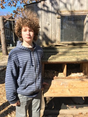 Ben Stephens next to Sweet Woodland Farm's nesting boxes. LISA DAFFY