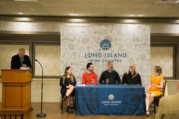 Long Island Wine Country President Roman Roth at the lectern with the panel at the Spring Portfolio Tasting: Hannah Selinger, Chad Walsh, David Loewenberg, Tom Schaudel and Aimée Lasseigne New. BRIDGET ELKIN